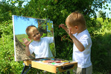 funny kid draws a picture on the mirror