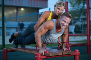 Fitness couple on a street workout