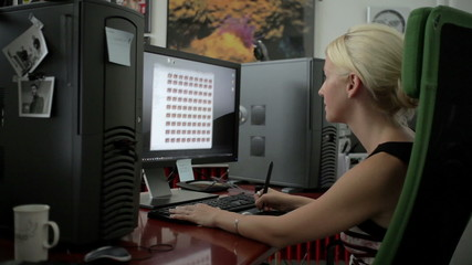Young Woman Using Computer indoor