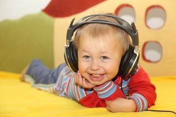 funny kid listening to music in headphones
