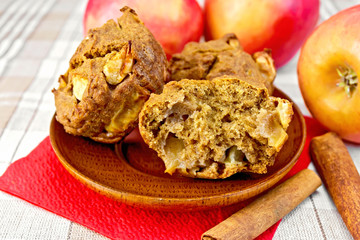 Cupcakes rye with apples in wooden plate on tablecloth