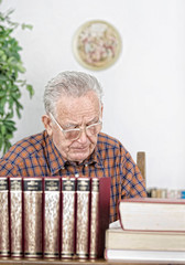 Senior man in library