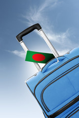Destination Bangladesh. Blue suitcase with flag.