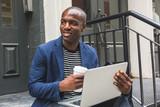 Fototapety Black Guy Using Notebook in New York