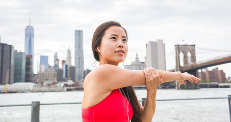 Asian Girl Doing Stretching Exercises in New York