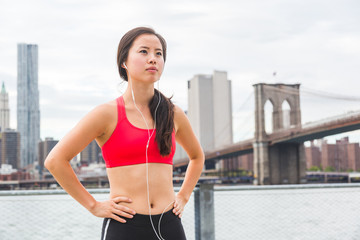 Asian Girl Resting After Fitness Exercises in New York