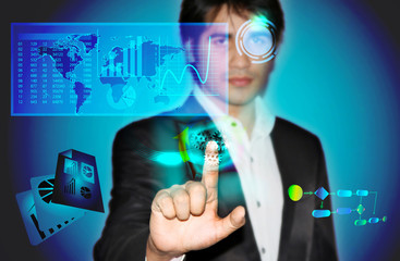 Business man with touch screen and business statistics