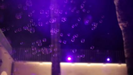 People dancing in soap bubbles