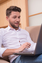 Handsome man with notebook computer