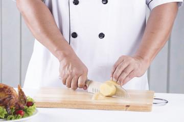 chef cutting potato