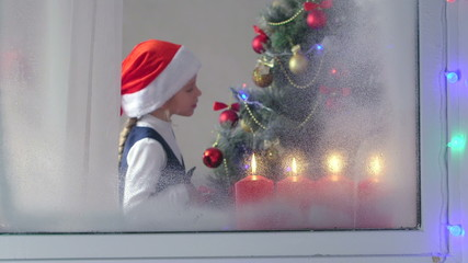 kids celebrate Christmas around a decorated tree