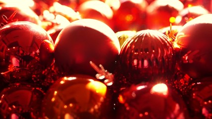 Close up, Shiny red and gold Christmas ball mistletoe ornaments