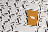 Delivery concept, shipping truck keyboard key.