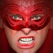 Portrait of angry man in red mask. Mental health concept.