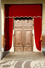 door italy  lombardy     in  the milano old   church   red tent
