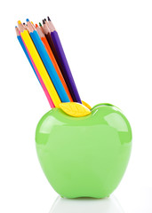 color pencils in green apple shaped holder