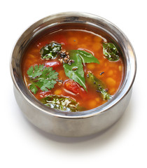 tomato rasam, south indian soup isolated on white background