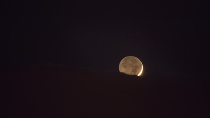 The moon with light clouds, close up time lapse video