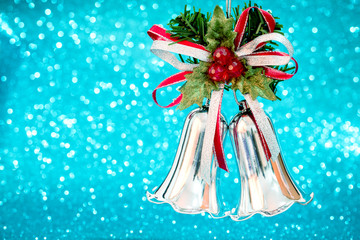 christmas silver bells gift on blue bokeh background