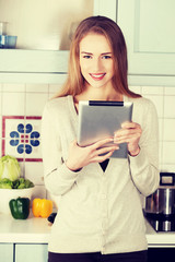 Beautiful caucasian woman working on tablet.