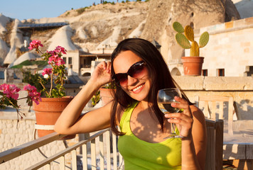 Young woman girl in sunglasses with wine