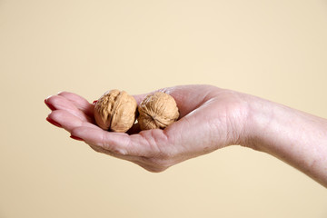 Walnuts in a woman's hand being crushed