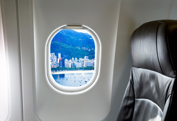Airplane seat and window inside an aircraft with Rio de Janeiro