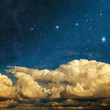 clouds and stars on a textured vintage paper  background