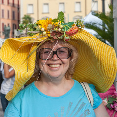 Shot of a woman with fruits head wear.