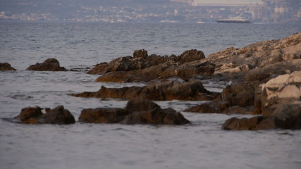 rocky bay boat in background