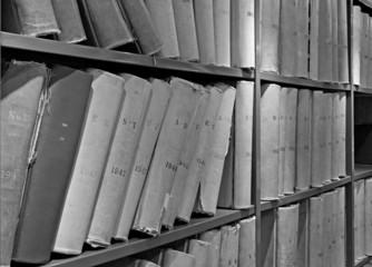 Old volume of library books on shelves