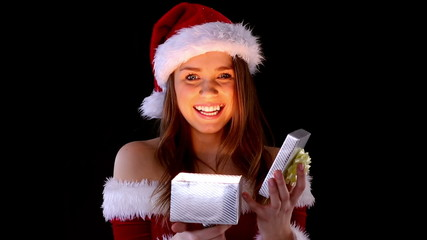 Smiling woman opening Christmas present