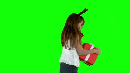 Little girl spinning with gift in slow motion