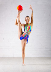 Young girl is engaged in art gymnastics