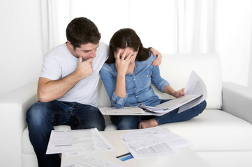 young couple worried home in stress accounting bank money debt
