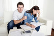 couple in stress husband comforting wife financial problems