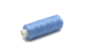 spool of thread of blue color on a white background