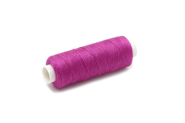 spool of thread lilac color on a white background