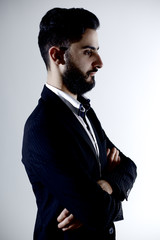 Serious young fashion model with beard thinking