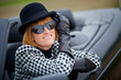 Stylish 40s woman happy with new Convertible