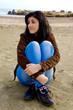 Young woman enjoying beach in autumn