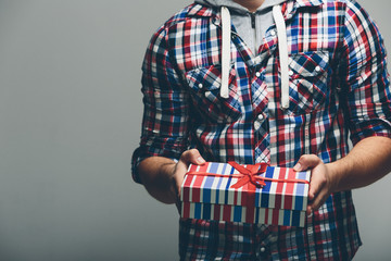 Man in Colored Shirt Holding Presents