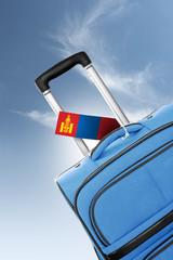 Destination Mongolia. Blue suitcase with flag.