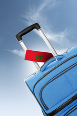 Destination Morocco. Blue suitcase with flag.