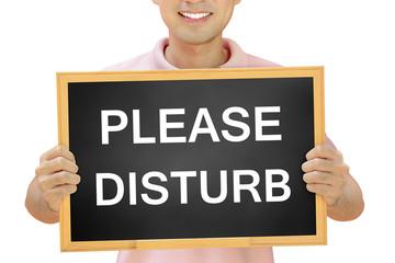 PLEASE DISTURB sign on blackboard - customer service concept