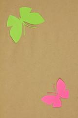 Homemade cardboard butterfly on beige paper