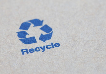 Blue recycle sign on a paper box product