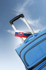 Destination Slovakia. Blue suitcase with flag.