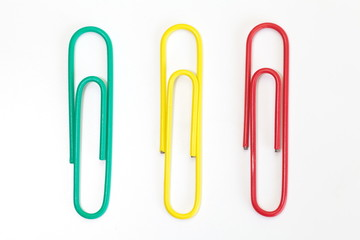 Color metal paper clip isolated on white background