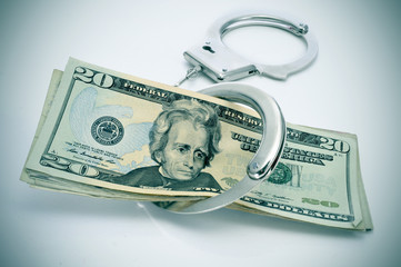 handcuffs and dollar bills